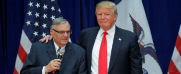Republican presidential candidate Donald Trump is joined onstage by Maricopa County Sheriff Joe Arpaio (L) at a campaign rally in Marshalltown, Iowa January 26, 2016, after Arpaio endorsed Trump's cacndidacy. REUTERS/Brian Snyder/File Photo