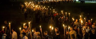 CHARLOTTESVILLE, USA - AUGUST 11: Neo Nazis, Alt-Right, and White Supremacists march through the University of Virginia Campus with torches in Charlottesville, Va., USA on August 11, 2017. (Photo by Samuel Corum/Anadolu Agency/Getty Images)