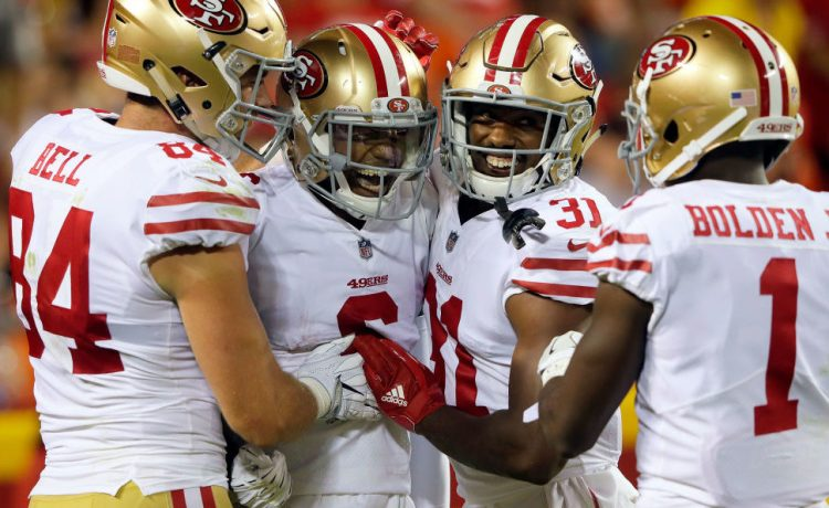 Wide receiver Kendrick Bourne #6 of the San Francisco 49ers is congratulated by teammates after catching a pass for a touchdown during the preseason game against the Kansas City Chiefs at Arrowhead Stadium on August 11, 2017 in Kansas City, Missouri. (Photo by Jamie Squire/Getty Images)