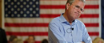 Republican presidential candidate Jeb Bush listens to a question from the audience during a town hall meeting campaign stop at the Medallion Opera House in Gorham, New Hampshire July 23, 2015. REUTERS/Brian Snyder TPX IMAGES OF THE DAY - RTX1LKI3