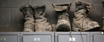 Coal mining boots are shown above miners' lockers before the start of an afternoon shift at a coal mine near Gilbert, West Virginia May 22, 2014. REUTERS/Robert Galbraith.
