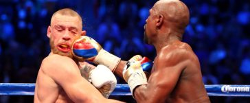 Floyd Mayweather Jr. lands a hit against Conor McGregor during the tenth round at T-Mobile Arena. Mandatory Credit: Mark J. Rebilas-USA TODAY Sports - via Reuters TPX IMAGES OF THE DAY TPX IMAGES OF THE DAY - RTX3DHP3