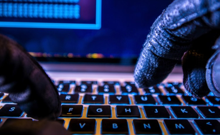Hacker at a keyboard (Photo: Shutterstock/welcomia)