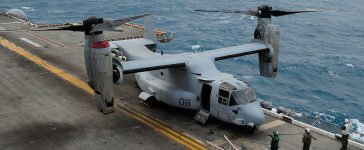 A MV-22 Osprey tiltrotor aircraft sits on the deck of the USS Bonhomme Richard (LHD 6) on July 30, 2013 near Rockhampton, Australia. Over 30,000 US and Australian troops are participating in Talisman Sabre, a joint military exercise off the coast of central Queensland. (Photo by Ian Hitchcock/Getty Images)