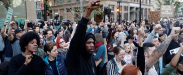 Demonstrators gesture in response to the Charlottesville, Virginia car attack in Oakland