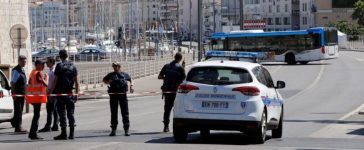 French police block the street after one person was killed and another injured after a vehicle crashed into two bus shelters, in Marseille, France, August 21, 2017. REUTERS/Philippe Laurenson