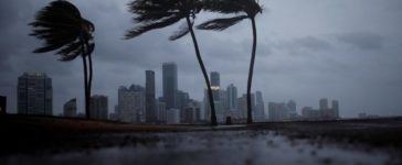 Dark clouds are seen over Miami's skyline before the arrival of Hurricane Irma to south Florida, U.S. September 9, 2017. REUTERS/Carlos Barria