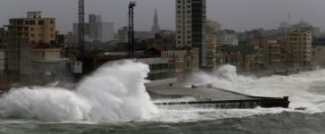 Waves crash against the seafront boulevard El Malecon as Hurricane Irma turns toward the Florida Keys on Saturday, in Havana