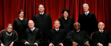 U.S. Chief Justice John Roberts (seated C) leads Justice Ruth Bader Ginsburg (front row, L-R), Justice Anthony Kennedy, Justice Clarence Thomas, Justice Stephen Breyer, Justice Elena Kagan (back row, L-R), Justice Samuel Alito, Justice Sonia Sotomayor, and Associate Justice Neil Gorsuch in taking a new family photo including Gorsuch, their most recent addition, at the Supreme Court building in Washington, DC, U.S. on June 1, 2017. (REUTERS/Jonathan Ernst/File Photo)