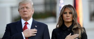 """WASHINGTON, DC - SEPTEMBER 11: U.S. President Donald Trump and first lady Melania Trump place their hands over their hearts on the South Lawn of the White House during the playing of """"Taps"""" at a ceremony marking the September 11 attacks September 11, 2017 in Washington, DC. Today marks the 16th anniversary of the attacks that killed almost 3,000 people and wounded another 6,000. (Photo by Win McNamee/Getty Images)"""