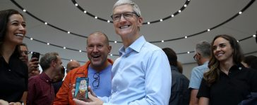 CUPERTINO, CA - SEPTEMBER 12: Apple CEO Tim Cook (R) and Apple chief design officer Jonathan Ive (L) look at the new Apple iPhone X during an Apple special event at the Steve Jobs Theatre on the Apple Park campus on September 12, 2017 in Cupertino, California. Apple held their first special event at the new Apple Park campus where they announced the new iPhone 8, iPhone X and the Apple Watch Series 3. (Photo by Justin Sullivan/Getty Images)