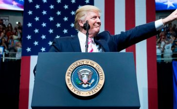 US President Donald Trump waves during rally a for Alabama state Republican Senator Luther Strange at the Von Braun Civic Center September 22, 2017 in Huntsville, Alabama. Trump is visiting the southern US state to endorse Luther Strange, a candidate for US Senate in the state's Republican primary. BRENDAN SMIALOWSKI/AFP/Getty Images