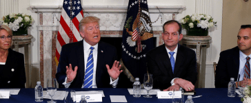 U.S. President Donald Trump, flanked by Education Secretary Betsy DeVos (L), Secretary of Labor Alex Acosta (2nd R) and Domestic Policy Council Director Andrew Bremberg (R), speaks to reporters before meeting with participants in a workforce apprenticeship discussion at Trump's golf estate in Bedminster, New Jersey U.S. August 11, 2017. REUTERS/Jonathan Ernst