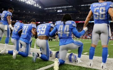 DETROIT, MI - SEPTEMBER 24: Members of the Detroit Lions take a knee during the playing of the national anthem prior to the start of the game against the Atlanta Falcons at Ford Field on September 24, 2017 in Detroit, Michigan. (Photo by Rey Del Rio/Getty Images)