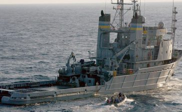 The U.S. Navy search and rescue vessel USNS Apache (T-ATF 172) is shown in this September 10, 2003 handout photo provided by the U.S. Navy during practice boarding procedures in the Atlantic Ocean. REUTERS/Mate 2nd Class Aaron