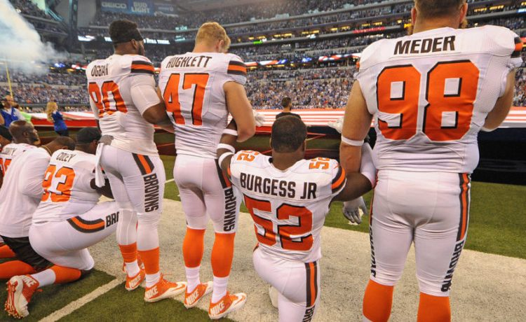The Cleveland Browns team stand and kneel during the National Anthem. Sep 24, 2017. (Photo: Thomas J. Russo - Reuters/USA TODAY Sports)