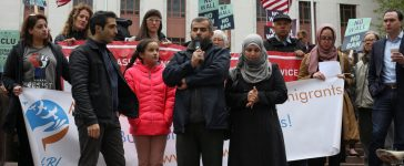 Mustafa Al-Mustafa, center right, a refugee from Syria, speaks with the help of a translator, Moh Kilani, left, while joined by his wife, Jamila Al-Mustafa, right, and daughter, Yamama, 11, center left, during a protest of U.S. President Donald Trump's travel ban outside of the U.S. Court of Appeals in Seattle, Washington, U.S. May 15, 2017. REUTERS/David Ryder