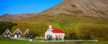 Shutterstock/ A small village in Iceland with church and turf houses (Alexey Stiop)