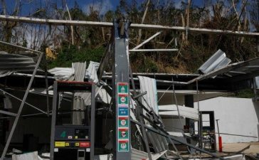 A gas station sits in ruins, after Hurricane Maria, in the municipality of Naranjito outside San Juan, Puerto Rico October 11, 2017. REUTERS/Shannon Stapleton