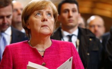 German Chancellor Merkel attends the 500th anniversary of the Reformation in front of the grave of Martin Luther at the Castle Church in Wittenberg
