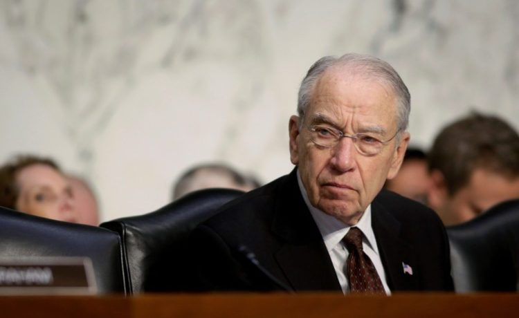 FILE PHOTO - Senate Judiciary Committee Chairman Chuck Grassley (R-IA) listens as U.S. Attorney General Jeff Sessions (not pictured) testifies before a Senate Judiciary oversight hearing on the Justice Department on Capitol Hill in Washington, U.S., October 18, 2017. REUTERS/Joshua Roberts