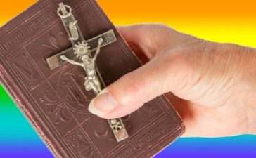 Bible Held In Front Of LGBT Flag (shutterstock/MyImages - Micha)