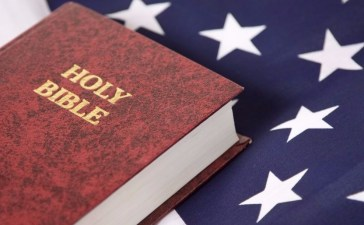 Bible on USA flag Shutterstock/Mark Hayes