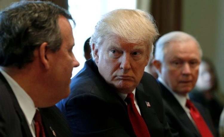U.S. President Donald Trump (2nd L), flanked by New Jersey Governor Chris Christie (L) and Attorney General Jeff Sessions (R), holds an opioid and drug abuse listening session at the White House in Washington, U.S. March 29, 2017. REUTERS/Jonathan Ernst