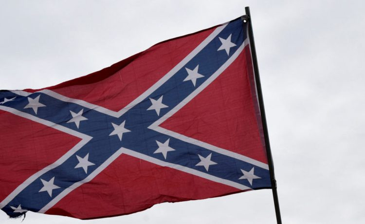 """Trevor Jackson displays a Confederate flag during a rally held by Sons of Confederate Veterans in Shawnee, Oklahoma, U.S. March 4, 2017. """"They are veterans and deserve to be honored,"""" said Jackson. REUTERS/Nick Oxford - RC1DA9D711D0"""