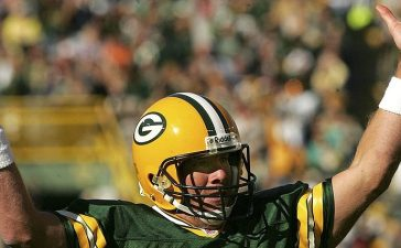 Brett Favre of the Green Bay Packers celebrates after the Packers scored their third touchdown in the first half against the Arizona Cardinals on October 2006 at Lambeau Field. (Photo by Stephen Dunn/Getty Images)