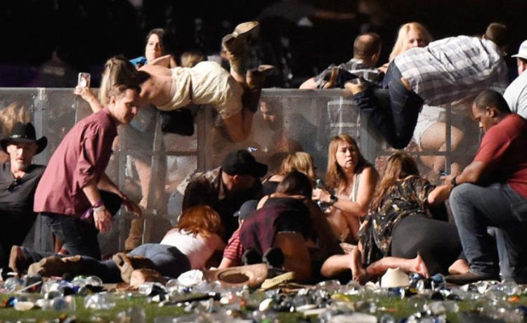 LAS VEGAS, NV - OCTOBER 01: People run from the Route 91 Harvest country music festival after apparent gun fire was heard on October 1, 2017 in Las Vegas, Nevada. (Photo by David Becker/Getty Images)