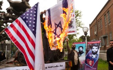 Iranian students burn a U.S. flag and an Israeli flag inside the former U.S. embassy in Tehran April 25, 2011. REUTERS/Raheb Homavandi