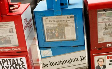 WASHINGTON - MAY 01: A Washington Post (C) vending machine is stocked with newspapers for sale on May 1, 2009 in Washington, DC. The newspaper has announced its first quarter earnings with a net loss of $19.5 million. (Photo by Alex Wong/Getty Images)
