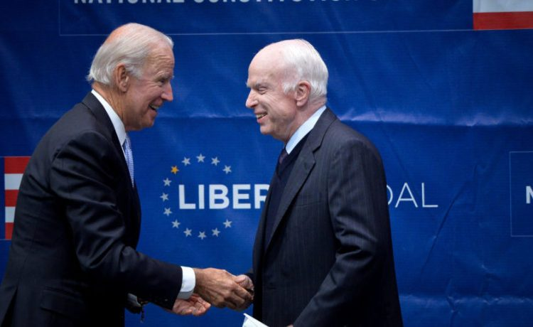 U.S. Senator John McCain (R-AZ) is awarded the 2017 Liberty Medal by former U.S. Vice President Joe Biden at the Independence Hall in Philadelphia, Pennsylvania, U.S., October 16, 2017. (REUTERS/Charles Mostoller)