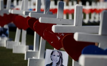 A photograph hangs from one of the 58 white crosses set up for the victims of the Route 91 music festival mass shooting in Las Vegas, Nevada, U.S., October 5, 2017. (REUTERS/Chris Wattie)