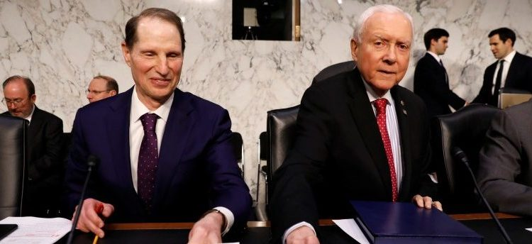 "Senate Finance Committee Chairman Orrin Hatch and ranking member Ron Wyden take their seats for a markup on the ""Tax Cuts and Jobs Act"" on Capitol Hill in Washington, November 13, 2017. REUTERS/Kevin Lamarque"
