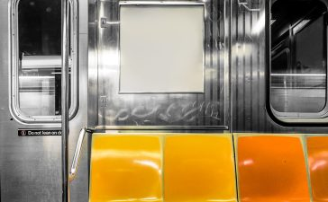 New York City subway car interior with colorful seats Shutterstock/ littlenySTOCK