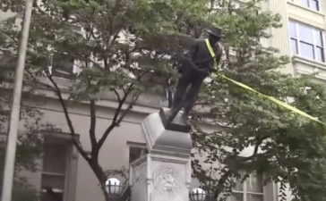 Protesters tear down a statue of a Confederate soldier in Durham, North Carolina. (Photo Credit: YouTube/NBC4 WCMH-TV Columbus)