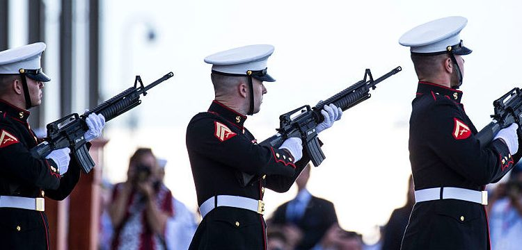 A U.S. Marine Corps unit fires a rifle salute during a ceremony commemorating the 75th anniversary of the attack on Pearl Harbor at Kilo Pier on December 07, 2016 in Honolulu, Hawaii. (Photo by Kent Nishimura/Getty Images)