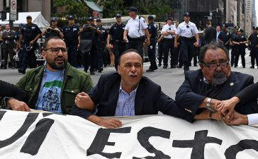 Congressman Adriano Espaillat (R), Speaker of the New York City Council Melissa Mark-Viverito (2nd R), Congressman Raul Grijalva (3rd R) and Congressman Luis Gutierrez (3rd L) sit on 5th Avenue blocking traffic, before getting arrested, during a rally to demand that U.S. President Donald Trump works with Congress to pass a clean DREAM Act on the sideline of the United Nations General Assembly in New York City, U.S. September 19, 2017. REUTERS/Darren Ornitz