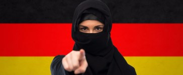 Muslim with German flag Getty Images/Syda Productions