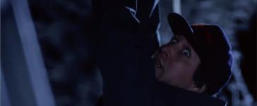 Clark Griswold putting up Christmas lights (YouTube screenshot/Warner Bros)