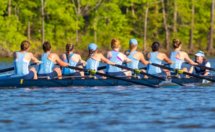 CARY, NORTH CAROLINA - APR 23: UNC woman get rowing workout on Jordan Lake on 23 Apr 2015 at Lake Jordan Shutterstock/ Harry Powell