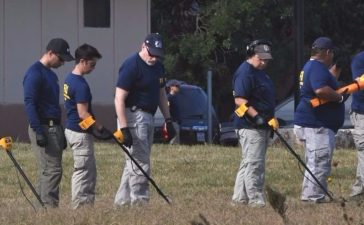 FBI agents search for clues at the entrance to the First Baptist Church, after a mass shooting that killed 26 people in Sutherland Springs, Texas on November 6, 2017. (Photo: MARK RALSTON/AFP/Getty Images)