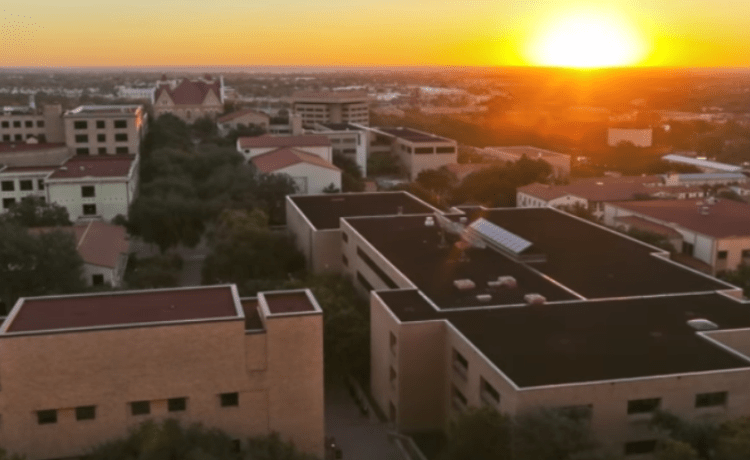 The sun sets over Texas State University. (Photo Credit: YouTube/Texas State University)