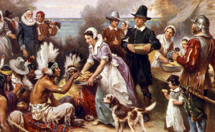The first Thanksgiving, 1621, Pilgrims and natives gather to share a meal, oil painting by Jean Louis Gerome Ferris, 1932. [Shutterstock - Everett Historical]