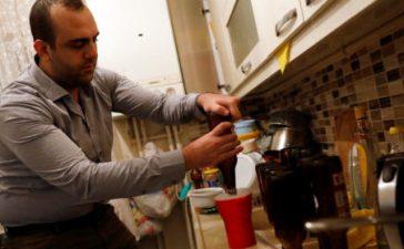 Onder Ceyhun, a 25-year old university student, brews his own beer at his home in Ankara, Turkey, November 6, 2017. REUTERS/Umit Bektas