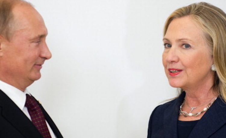 US Secretary of State Hillary Clinton (R) talks with Russian President Vladimir Putin during the arrival ceremony for the Asian-Pacific Economic Cooperation (APEC) Summit in Vladivostok, Russia, September 8, 2012. AFP PHOTO/POOL/Jim WATSON (Photo credit should read JIM WATSON/AFP/GettyImages)