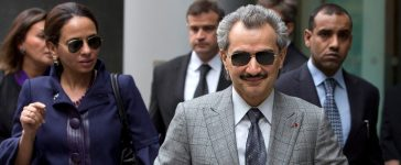 Prince Alwaleed bin Talal (R) leaves the High Court in London July 2, 2013. The billionaire prince, a nephew of Saudi Arabia's King Abdullah and one of the world's richest men, is being sued by Jordanian businesswoman Daad Sharab for $10 million over the sale of a private jet to Libya's Muammar Gaddafi. REUTERS/Neil Hall