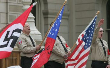 Members of the Neo Nazis National Socialists Movement (NSM) rally on the steps of the State Capital in East Lansing, Michigan April 22, 2006. About 80 NSM members rallied for two hours while a heavy police presence kept the NSM and 500 counter-demonstrators separate. REUTERS/Rebecca Cook